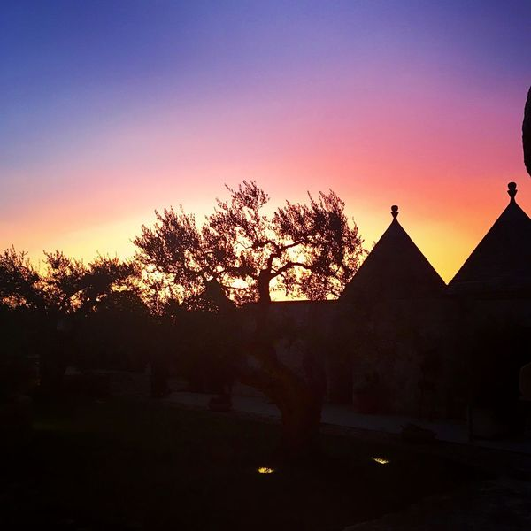 Most stunning sun set over trulli, traditional southern Italian farmhouses, in Cisterninio Southern Italy Italy Puglia Trulli Sunset Silhouette Tree Sky Built Structure Architecture Nature Tranquility Outdoors Scenics Beauty In Nature No People