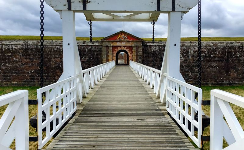 The imposing entrance of Fort George near Inverness, Highlands of Scotland EyeEm Best Shots Uk Scotland Highlands Inverness Bridge Fort George Fort Entrance Entry The Way Forward Cloud - Sky Built Structure Railing Architecture Wood - Material Footbridge Sky Wood Paneling Outdoors Nature Day