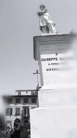 Combattei io per questo ....? Blackandwhite Photography Monument Statue Historical Monuments Mazzini Italy Italian History Street Photography Close-up Sky Dissolving