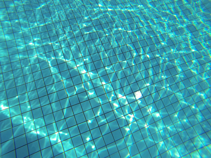 Underwater light and shadow Backgrounds Blue Close-up Full Frame Illuminated Light And Shadow Line And Shape Low Angle View Night No People Outdoors Pattern Pool Refraction Swimming Pool Tile Water