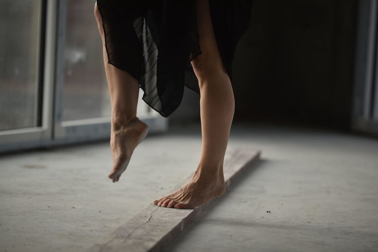 Low section of woman dancing on floor