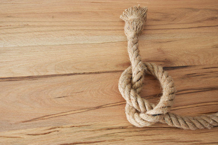 Close-up of rope on wooden table