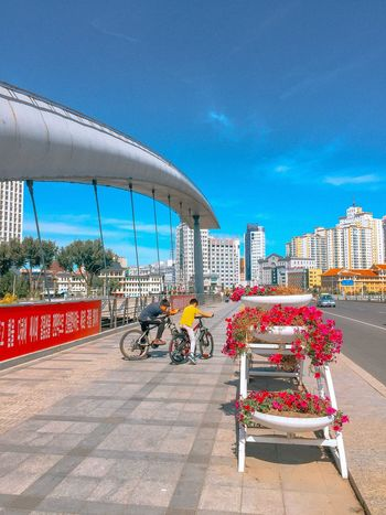 Sunny day in Yanji EyeEmNewHere Bridge Children China Yanji Architecture Building Exterior Built Structure City Sky Nature Transportation Incidental People Road Travel Destinations Blue Day Street EyeEmNewHere