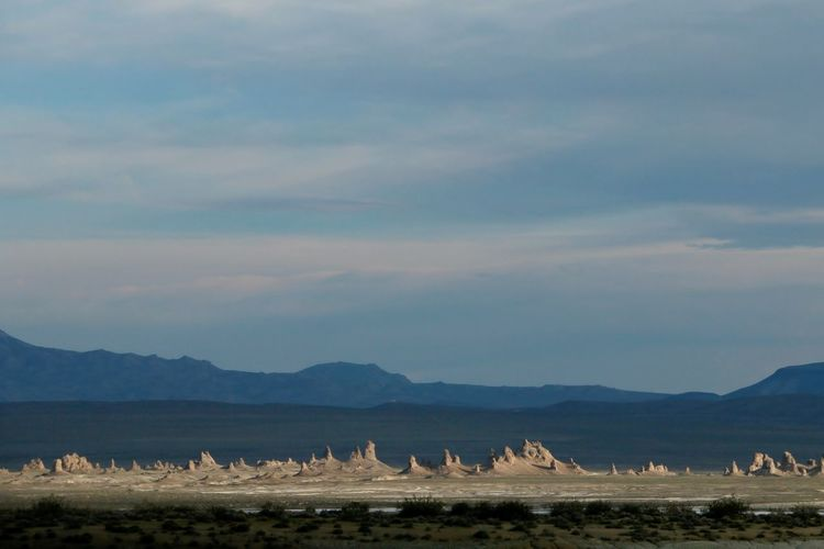 Underwater formations in dried up lake Desert Pinnacles Rock Formations Beauty In Nature Dried Up Lake Geology Landscape Mountains Nature No People Outdoors Sky Sunlight And Shadow Tranquil Scene Tranquility Trona Pinnacles