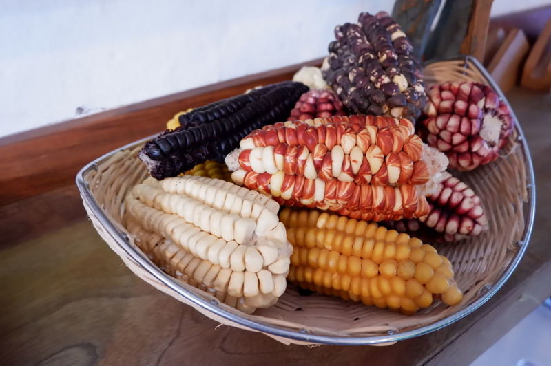 Close-up of corns in basket on table