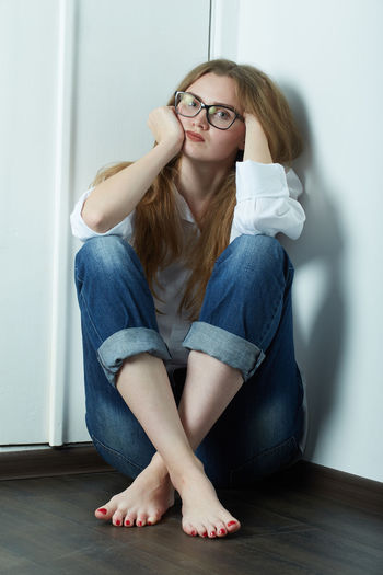 Young woman sitting in eyeglasses