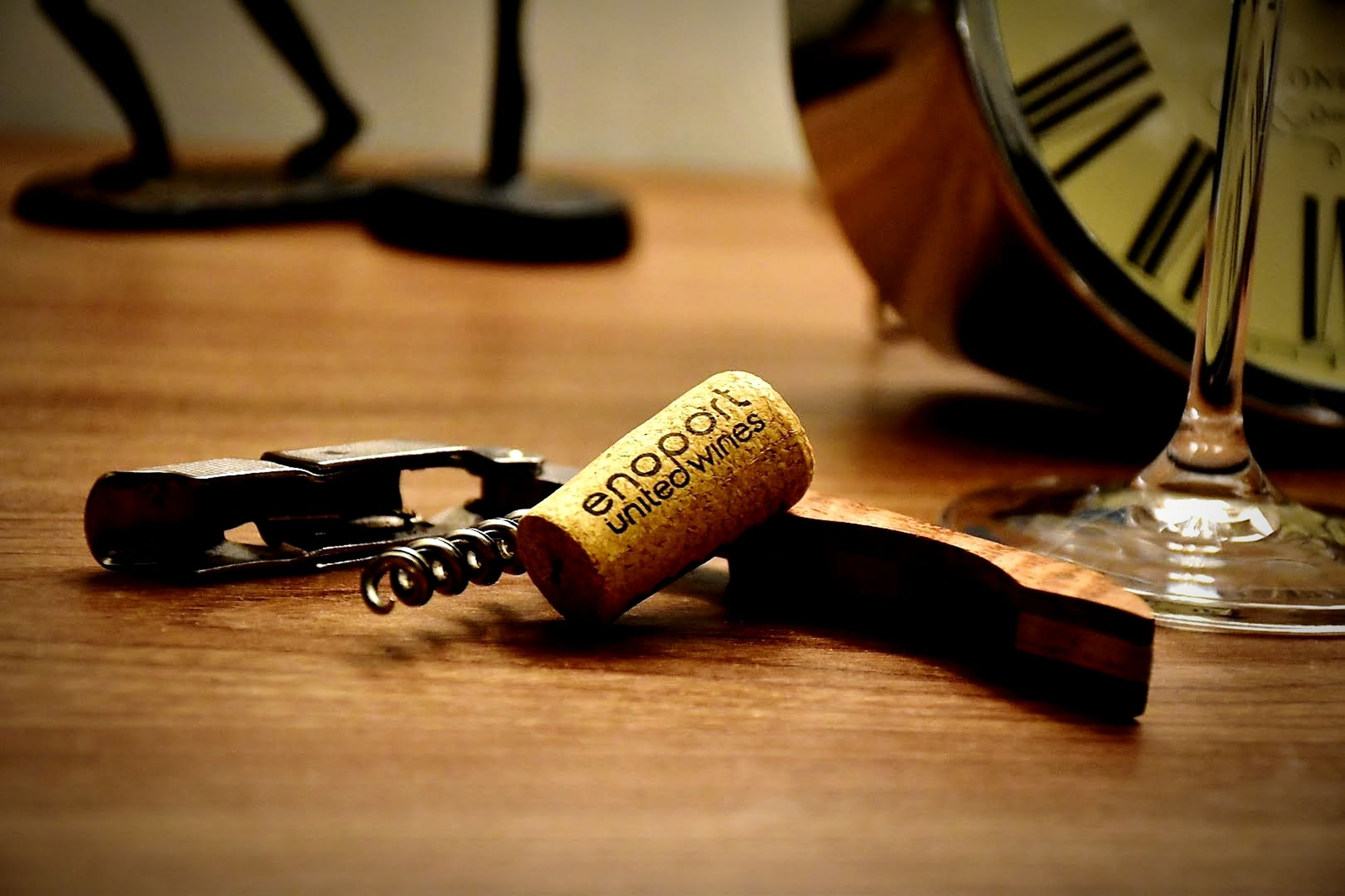 table, indoors, still life, wood - material, no people, close-up, refreshment, selective focus, drink, text, alcohol, food and drink, corkscrew, wine cork, flooring, bottle, time, antique, book
