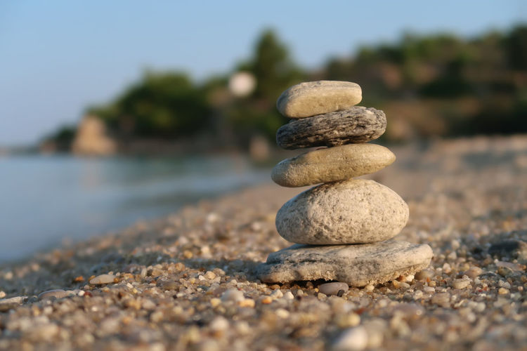 Stone balancing Sea Beach Water Nature Yoga Stones Sunlight Day Stone Outdoors Rock Tranquility Zen Stacked Balance Buddhism Close-up Stack Solid Pebble No People Selective Focus Rock - Object Stone - Object Zen-like Sand Stack Rock Stacked Stones