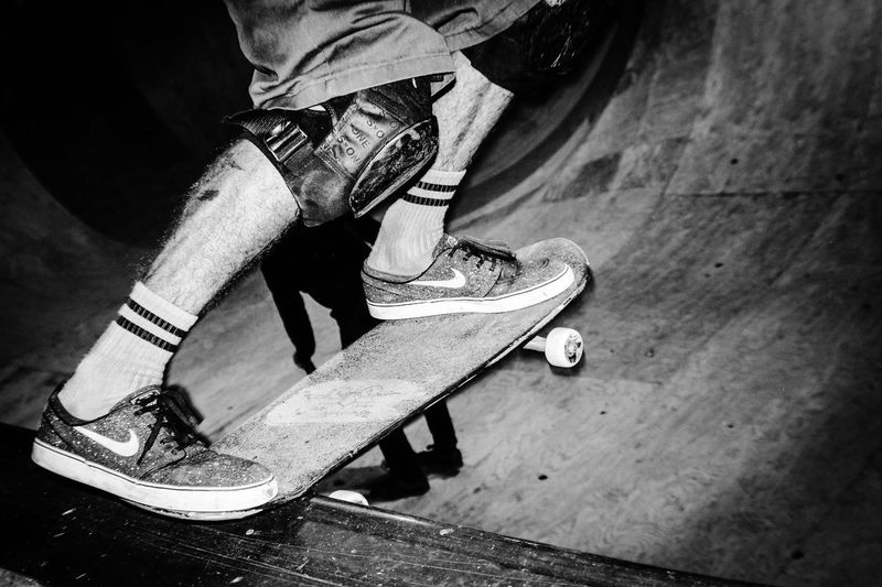 Low section of man skateboarding