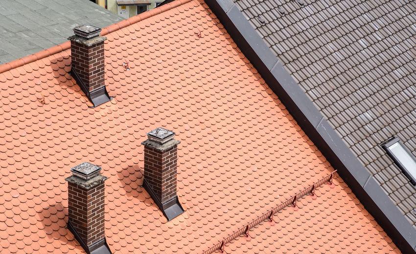 High angle view of smoke stacks on roof