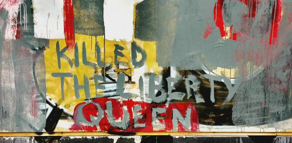 Graffiti Street Art Built Structure Architecture No People Close-up Outdoors Graffiti Wall Urbanphotography Textures And Surfaces Paint Splattered Paint Building Exterior Libertyqueen Liberty Killed Text Handwritten Brush Red Yellow Grey Slogan Signofthetimes Trump