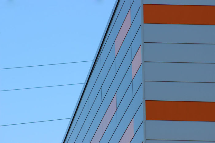 Architecture Blue Built Structure Cable Clear Sky Connection Day Gray High Section Low Angle View Multi Colored No People Orange Color Outdoors Power Line  Red Repetition Steel Cable Tall
