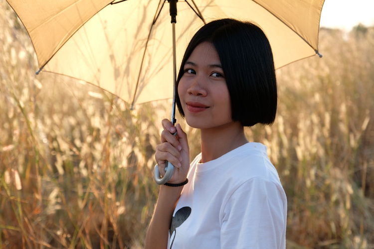 Thai Beauty Asian Woman Asian Girl Chinese Girl Chiness Style Thai Woman Thai Girls One Person Real People Umbrella Holding Leisure Activity Portrait Focus On Foreground Lifestyles Protection Young Adult Young Women Headshot Women Day Standing Casual Clothing Looking At Camera Beautiful Woman Outdoors Hairstyle