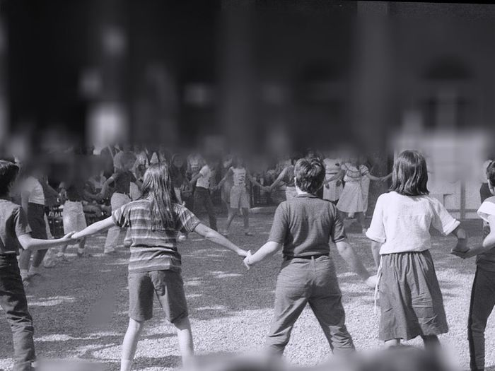 Children holding hands while playing in playground