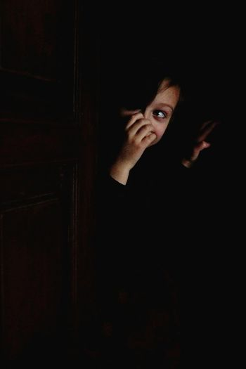 Calmness Alone Boy Elementary Age Eye Hand Darkness Looking Hand On Face In The Wardrobe Black Background Dark