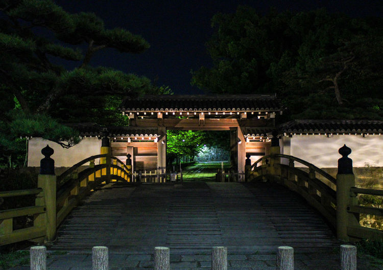 View of bridge and building at night