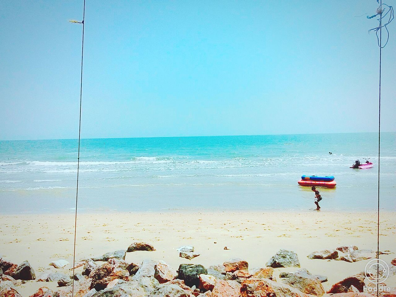 sea, horizon over water, water, beach, real people, shore, clear sky, nature, day, scenics, beauty in nature, men, full length, outdoors, one person, lifestyles, blue, sky, people
