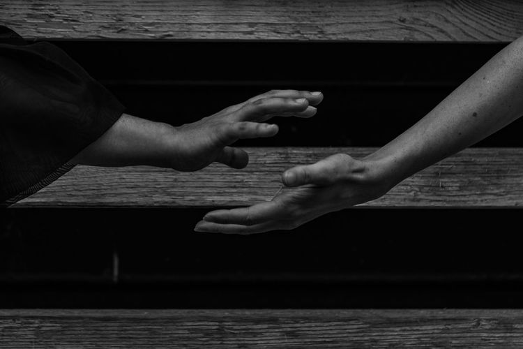 Body Language (Evolving) ~ The Still Life Photographer - 2018 EyeEm Awards Body Part Day Finger Hand Human Body Part Human Hand Human Limb Leisure Activity Lifestyles Light And Shadow Monochrome Nature People Real People Sea Still Life Symbolism Table Togetherness Two People Unrecognizable Person Women Wood - Material