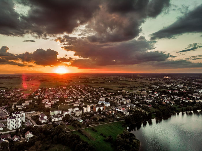 Sunset in a city Water Dark Water Drone  Dronephotography Drone Photography Droneshot Aerial View Grass Above Above The Ground EyeEm Selects Look Lake View Lakeshore Aerial Shot Above The Lake Nightphotography Night Lights Vievis Lithuania Lietuva Night #urbanana: The Urban Playground City Sunset Agriculture Flower Sun Storm Cloud Beauty Sunlight Summer Dramatic Sky Calm Waterfront Boat Skyline Lake River Standing Water Canal Romantic Sky Moody Sky Blooming Shore Coast Farmland Horizon Over Water EyeEmNewHere Summer In The City