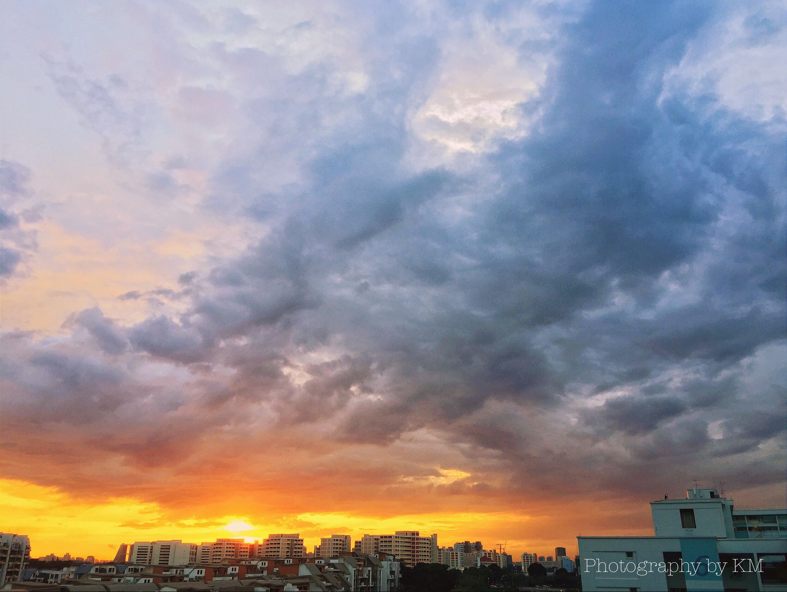 sunset, building exterior, architecture, built structure, sky, cloud - sky, city, orange color, cityscape, cloudy, dramatic sky, weather, residential building, silhouette, beauty in nature, residential structure, scenics, overcast, cloud, residential district