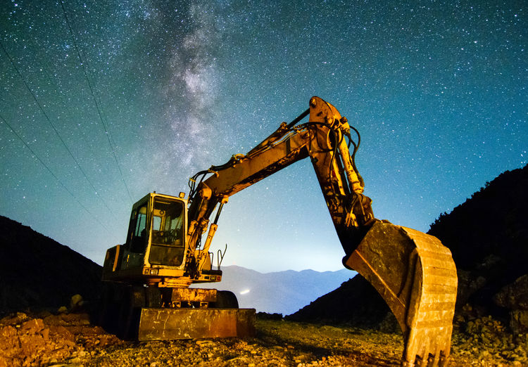 Earth Mover On Field Against Star Field At Night