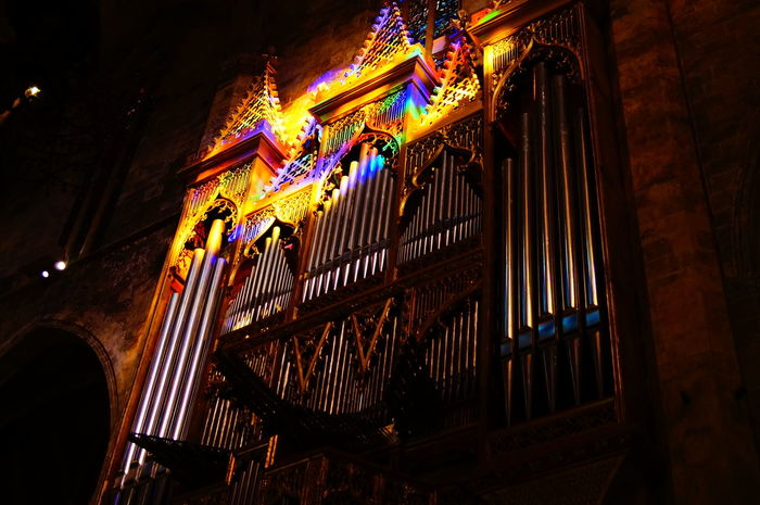 Built Structure Cathedral Church Colorful Dark Illuminated Low Angle View Multi Colored Organ Place Of Worship Sun Light Reflection