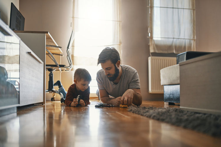 Father and son on floor