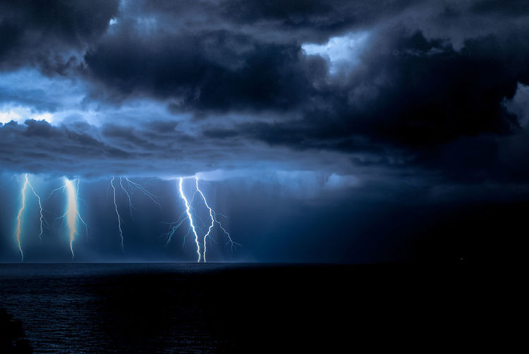 a single shot of arriving storm in Tigullio Gulf, Italy Beauty In Nature Dramatic Sky Electric Flash Illuminated Lightning Liguria,Italy Nature Night Outdoors Power In Nature Sea Sky Storm Storm Cloud Water Waterfront Weather