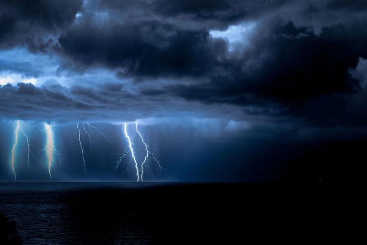 Idyllic Shot Of Lightning Over Sea