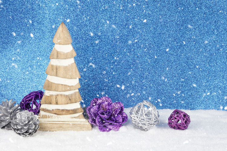 Close-Up Of Christmas Decorations On Snow