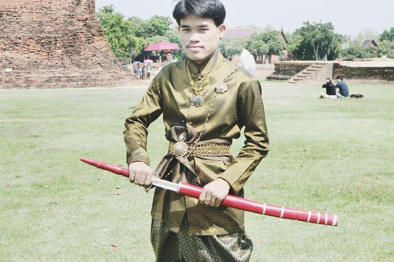 Portrait of boy on field
