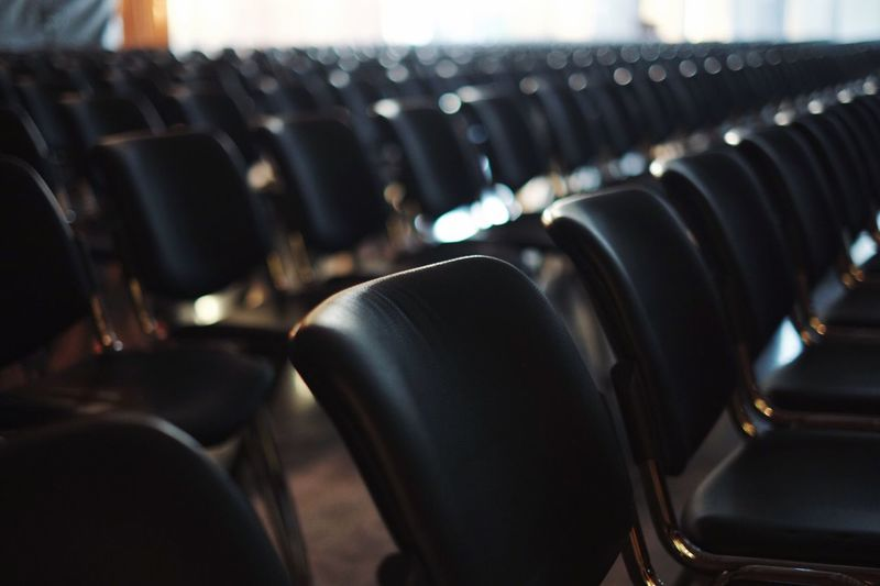 Empty Chairs In Auditorium