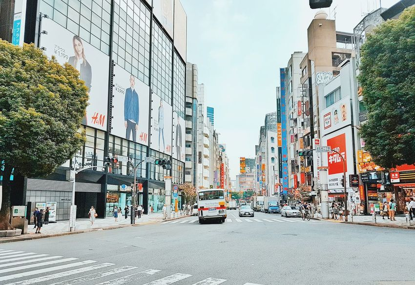 渋谷区 東京 都会 Shibuya Tokyo Architecture Car Building Exterior Built Structure Outdoors Day City Travel Destinations Sky Yellow Taxi People Travel Travel Photography Streetphoto Streetphotography Urban Japan Japan Photography The Street Photographer - 2017 EyeEm Awards