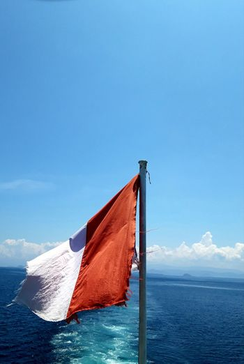 Indonesian flag flow with the ship