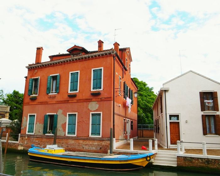City Architecture Nautical Vessel Building Exterior Street Built Structure Cityscape Town Red Row House House Apartment Sky Urban Skyline Façade Outdoors No People Water Medieval Day Venice Italy Venezia Transportation Connection