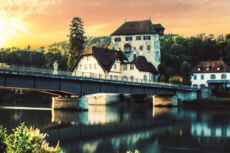 Kaiserstuhl Border Swiss-Germany Bridge - Man Made Structure Swiss Switzerland Switzerlandpictures Travelphotography Travel Destinations Travel Photography EyeEmNewHere First Eyeem Photo Architecture Built Structure Building Exterior Tree Water River No People Outdoors Sky Day Nature