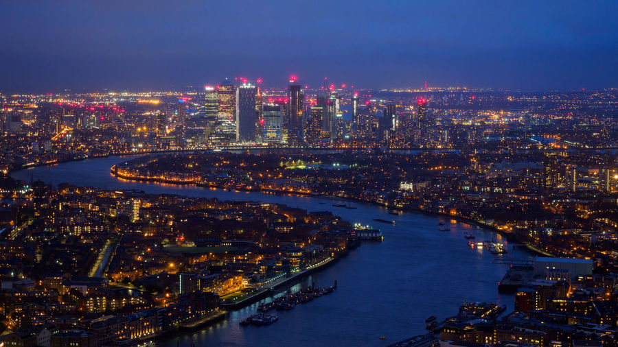 View towards the Thames and Canary Wharf just after Sunset City Building Exterior Architecture Cityscape Built Structure Building Water Illuminated Office Building Exterior Sky Travel Destinations Urban Skyline Night Residential District Landscape City Life No People River Nature Skyscraper Outdoors Modern Canary Wharf Thames River Sunset