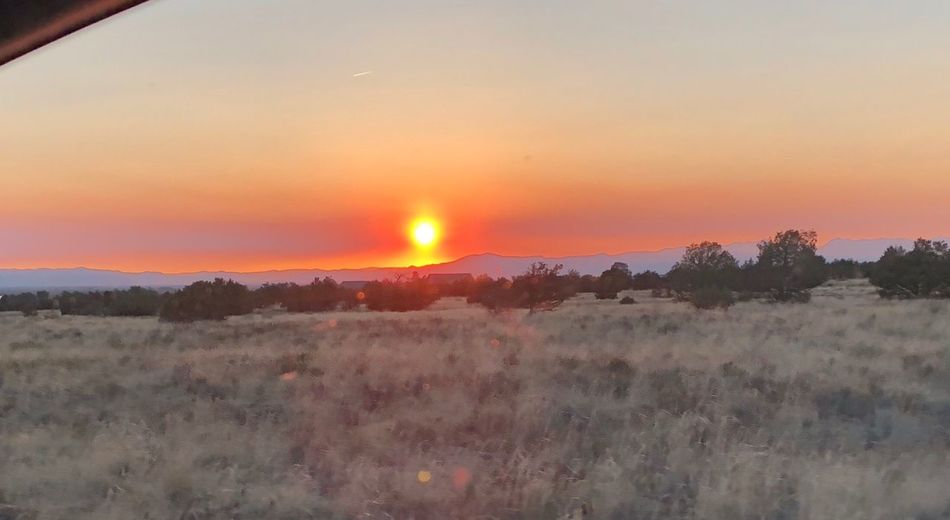 Smoky sunset Colorado Smoky Sunset Sunset Sky Beauty In Nature Scenics - Nature Tranquility Tranquil Scene Plant Environment Landscape Land Sun Field Orange Color Nature Cloud - Sky