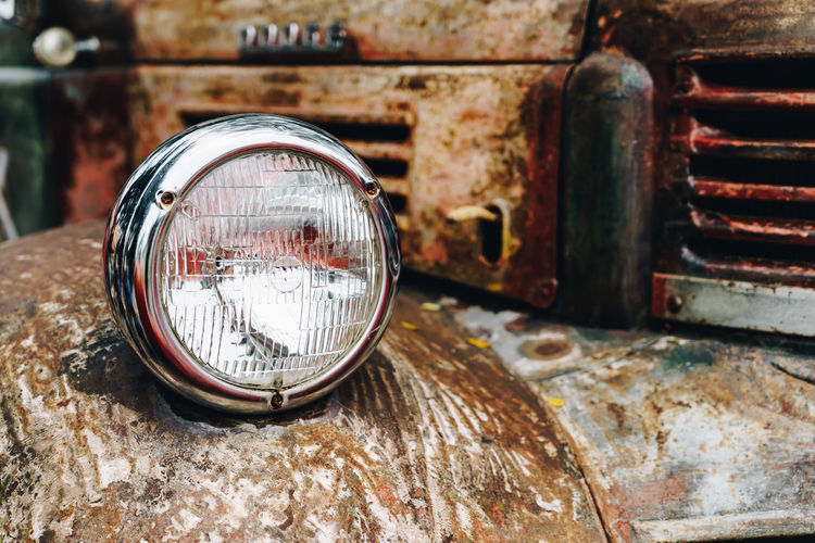 Close-up of old rusty car headlight