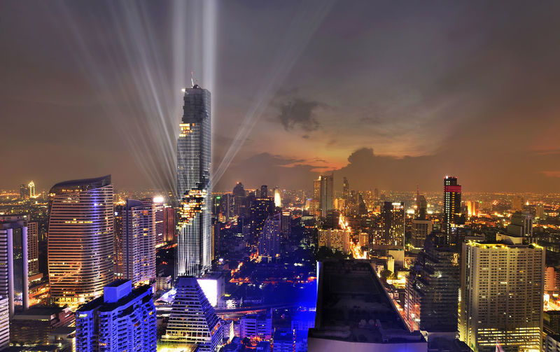 "Light show of new tallest building name is ""Mahanakorn"" in Bangkok, Thailand. Architecture Bangkok, Thailand. Building Exterior Business Business Finance And Industry City City Life Cityscape Development Downtown District Finance Futuristic Illuminated Modern Night No People Office Building Exterior Outdoors Sky Skyscraper Travel Travel Destinations Urban Skyline"