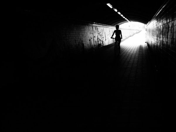 Biking through the tunnel. Bike Bicycle Tunnel Blackandwhite Black And White Black & White Streetphotography Streetphoto_bw Dark On Your Bike