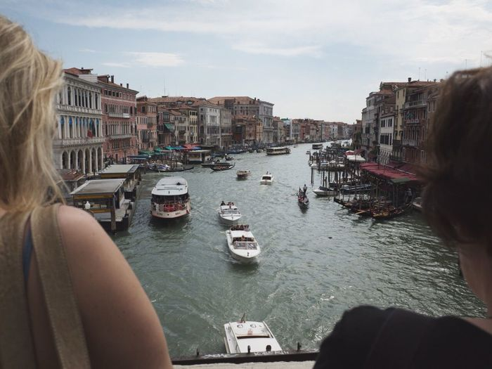 Two Women Looking At Canal
