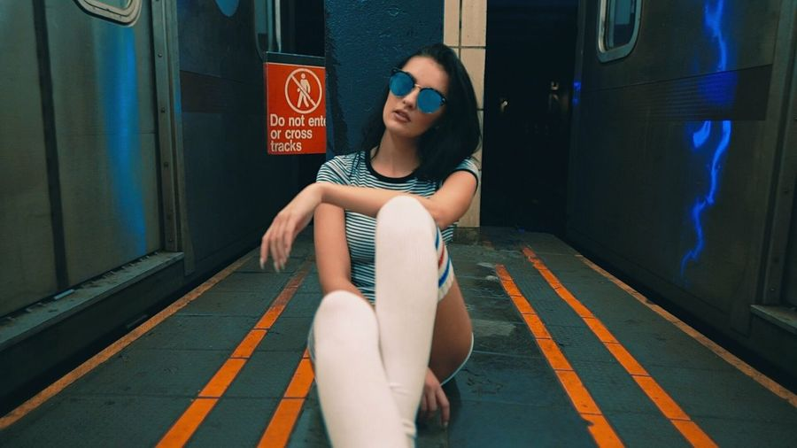 Real People One Person Lifestyles Sitting Full Length Person Day Built Structure Beautiful Woman Text Young Women Outdoors Young Adult Architecture Low Section City Life Music Video City Screenshot Danywild Subway Moody Musicvideo Fashion Mood