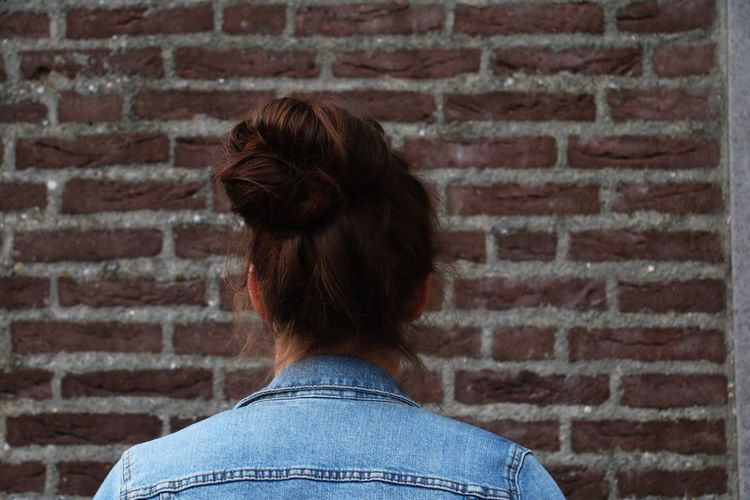 💇🏼 Brick Wall Rear View Headshot Lifestyles Wall - Building Feature Leisure Activity Focus On Foreground Bun Messy Bun Messy Bunn Hair Hairstyle