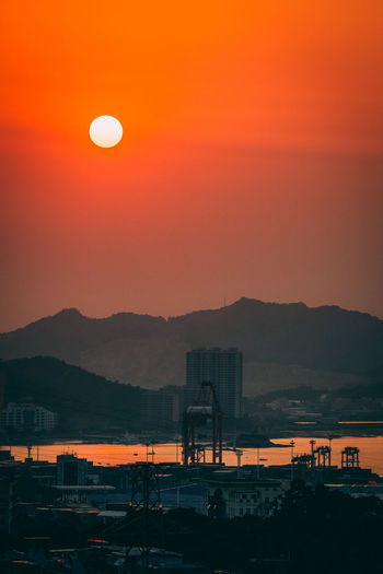 Architecture Astronomy Beauty In Nature Built Structure Drilling Rig Dusk Illuminated Industry Moon Mountain Nature Night No People Oil Pump Orange Color Outdoors Scenics Silhouette Sky Sunset