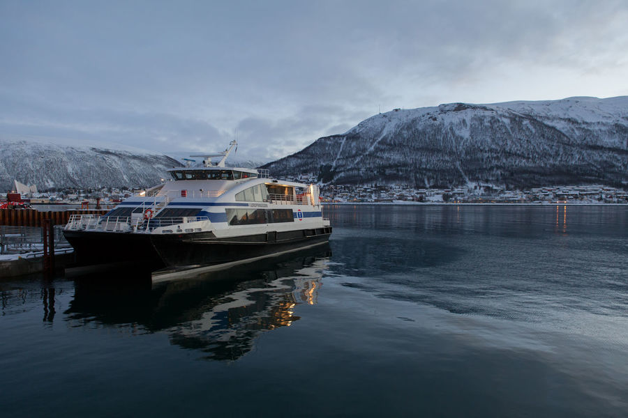 Arctic Boat Calm City Cold Dusk Ferry Fjord Frozen Mode Of Transport Nautical Vessel Norway Outdoors Polar Night Rippled Snow Tourism Tranquil Scene Tranquility Travel Destinations Troms Tromsø Water Winter