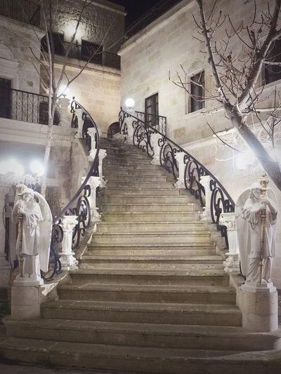 Statue of illuminated staircase