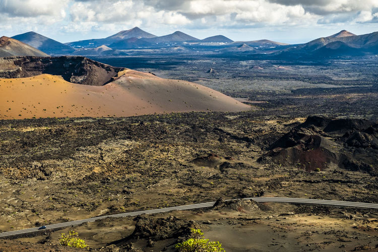 Lanzarote in Canary Islands Spain Beauty In Nature Cloud Cloud - Sky Day Europe Geology Idyllic Landscape Lanzarote Majestic Mountain Mountain Range Nature No People Non-urban Scene Outdoors Physical Geography Remote Scenics Sky SPAIN Tourism Tranquil Scene Tranquility Travel Destinations