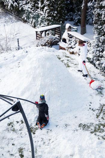 Man with umbrella on snowcapped mountain