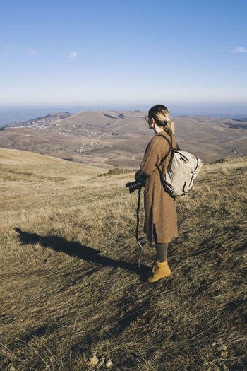 Woman Looking At Scenic View While Standing On Zlatibor Mountain Against Sky